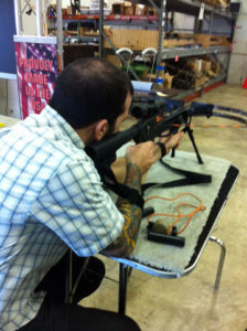 Dan Homa, graphic designer at Nu-Art, takes aim with the Kodabow